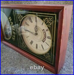Baileys Irish Cream Wall Clock wood and glass case 19 x 11.5 x 3.5