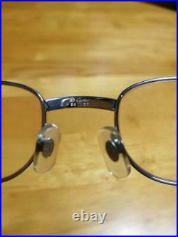 Cartier wood frame glasses with case
