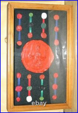 Collection Of Royal Wax Seals Displayed Within Large Wood and Glass Display Case